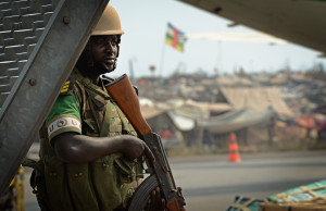 A Rwandan soldier guards a refugee camp in Bangui. Photo courtesy US Air Force/Flickr.