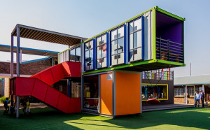 Brilliant in colour and execution. SEED Library II in Alexandra Township, Johannesburg, South Africa, was assembled quickly and inexpensively from recycled shipping containers. Kids are attracted by the building's whimsical appearance. Photo courtesy Andrew Moore/flickr