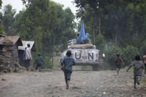 Picture of boy running after United Nations (UN) truck in Goma